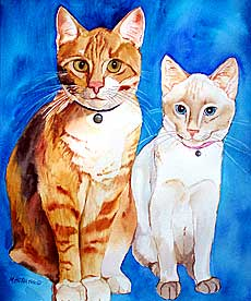 Portrait of orange tabby and siamese cat.