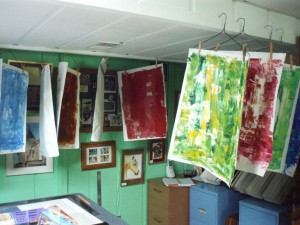 Collage papers hanging up to dry.